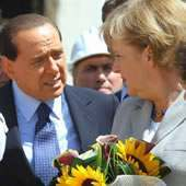 italian-prime-minister-silvio-berlusconi-and-german-chancellor-angela-merkel-during-the-visit-in-onna-laquila-as-part-of-the-g8-summit1