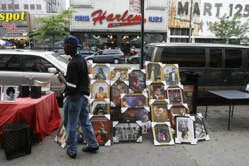 Street vendors sell Michael Jackson souvenirs in light of his recent death, in Harlem, in New York City on July 7, 2009. Rob Kim /Landov