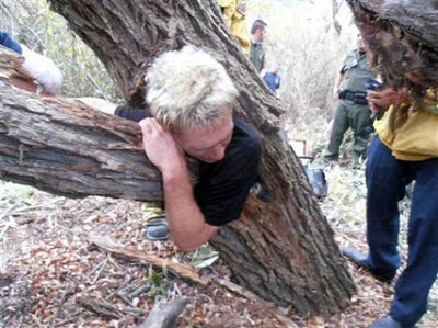man-stuck-in-tree-trunk