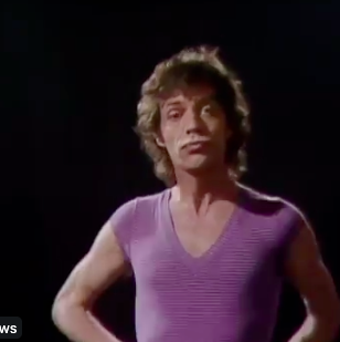 Mick Jagger dances to the theme from 'On The Buses'