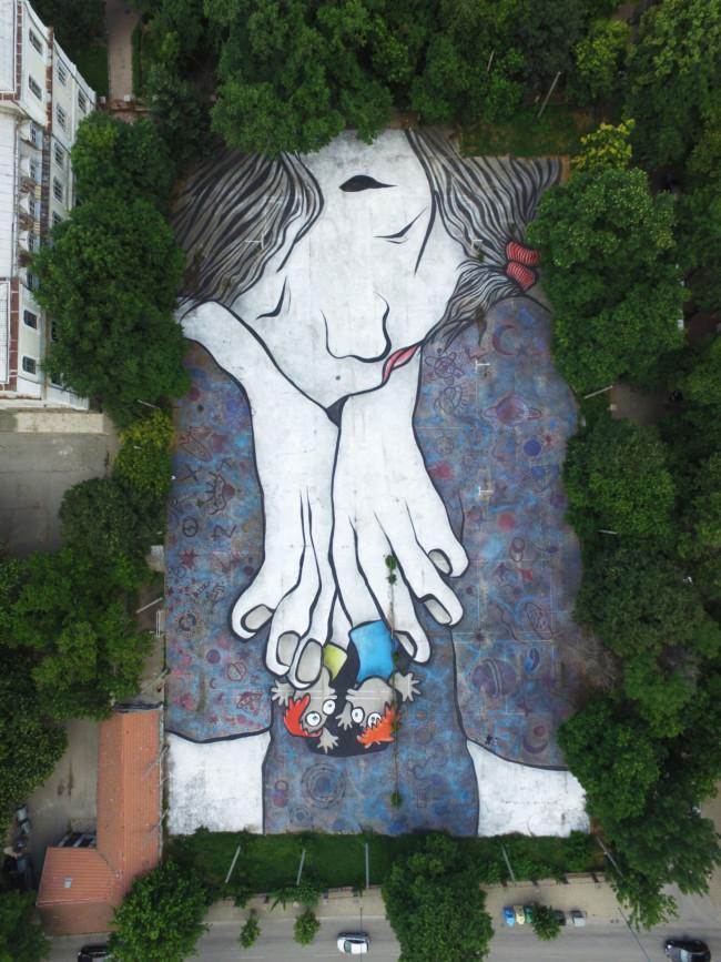 Artist Ella & Pitr rooftop mural giants
