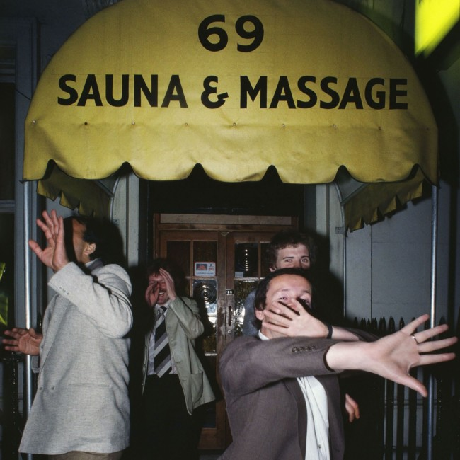 William Klein Men hidden their faces : 69 Sauna & Massage © William Klein